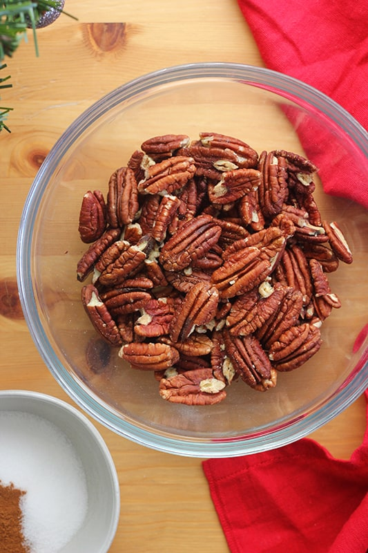 pecan halves in a glass bowl on a table top