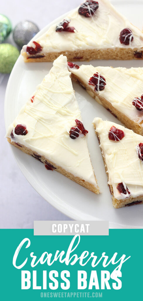 Starbucks Copycat Cranberry Bliss Bars. This holiday treat is made with a sweet shortbread cake, topped with cream cheese frosting, and drizzled with white chocolate!