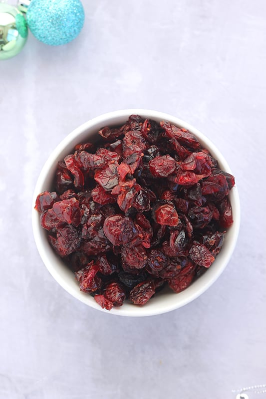 Bowl of craisins on white counter