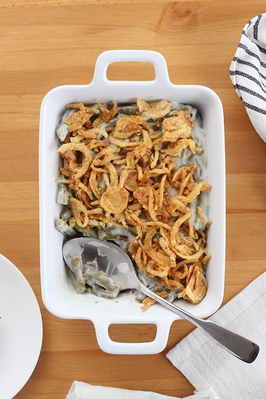 Homemade green bean casserole with spoon in dish