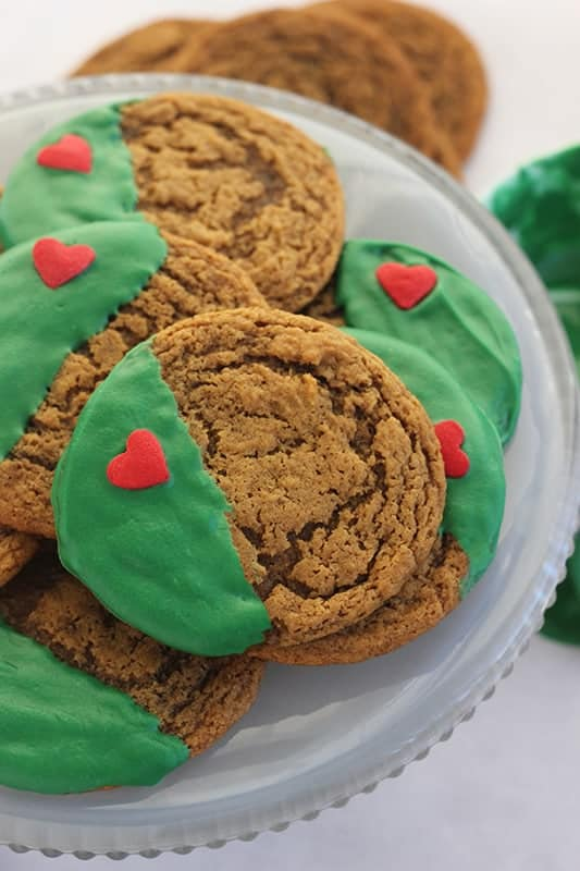 Stack of Grinch cookies on plate