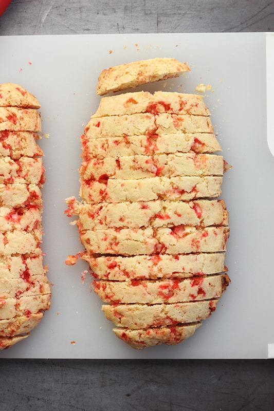 Candy Cane Biscotti being sliced on cutting board