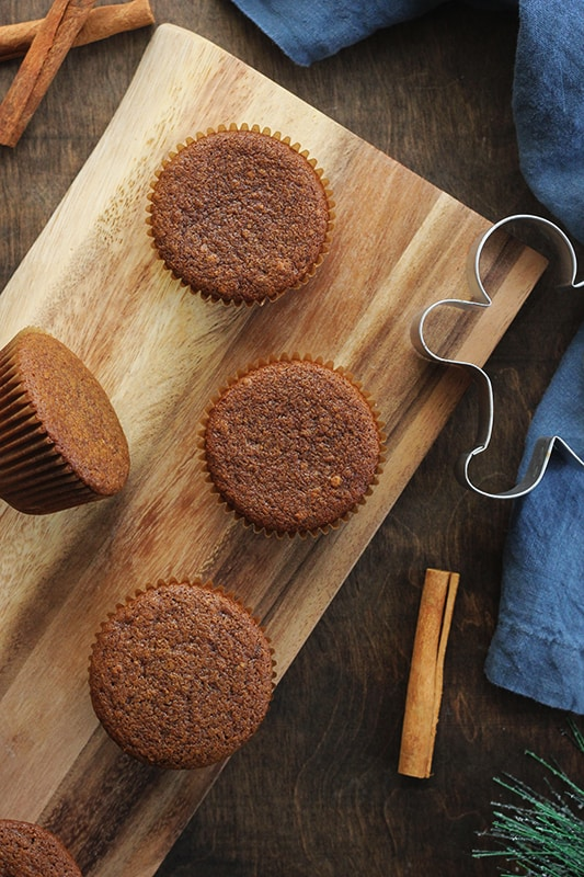 unfrosted gingerbread cupcakes on wooden platter