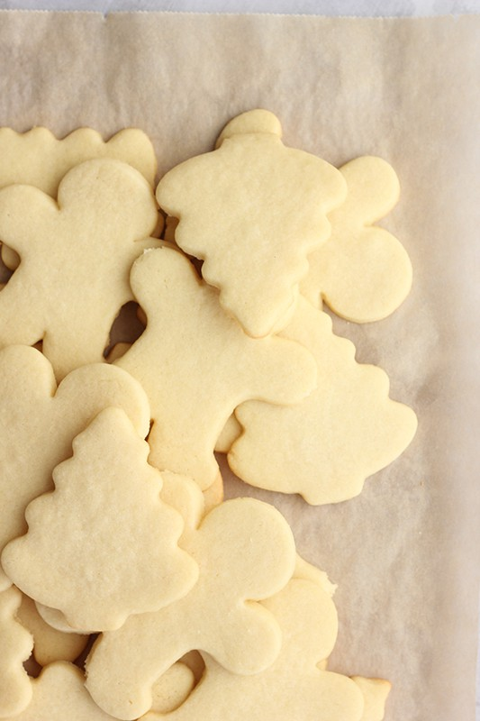 undecorated cut out sugar cookies on brown parchment paper