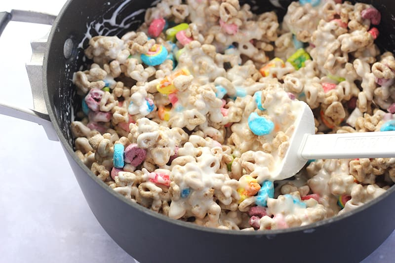 lucky cereal treats stirred together in a bowl