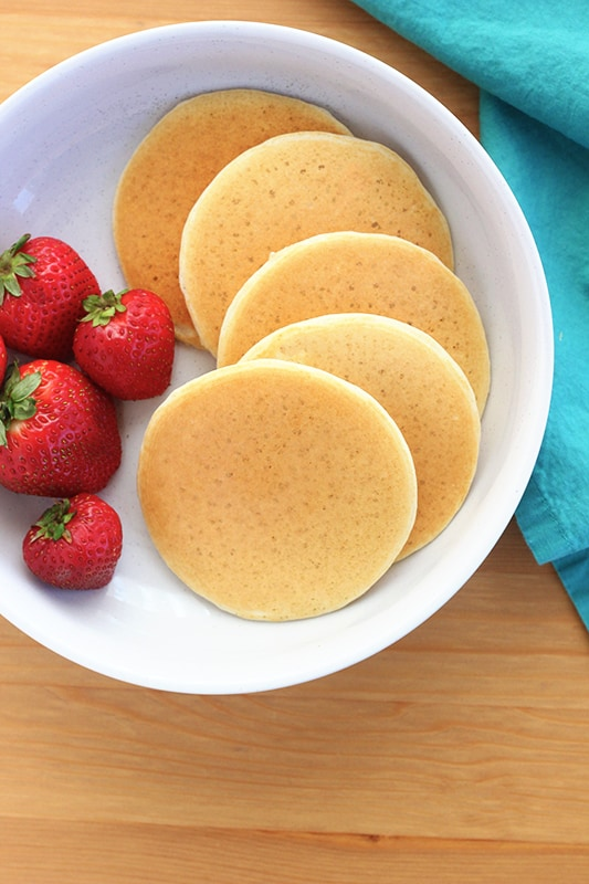 Mini Pancakes on a white plate with strawberries