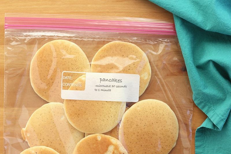 mini pancakes in a freezer safe bag with heating instructions