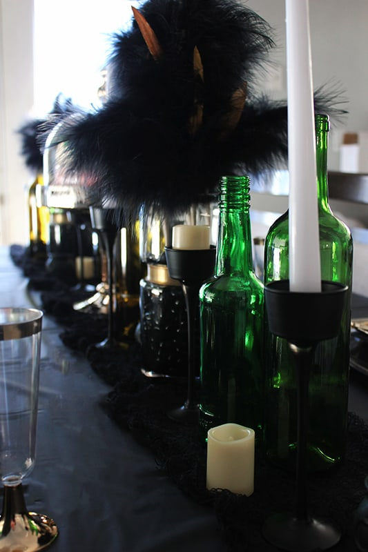 Potion bottles and candles on a party table
