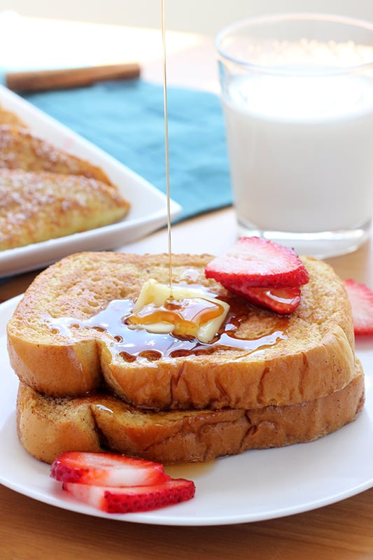 syrup being poured over cinnamon french toast