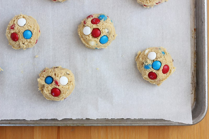 M&M cookie dough on a baking tray