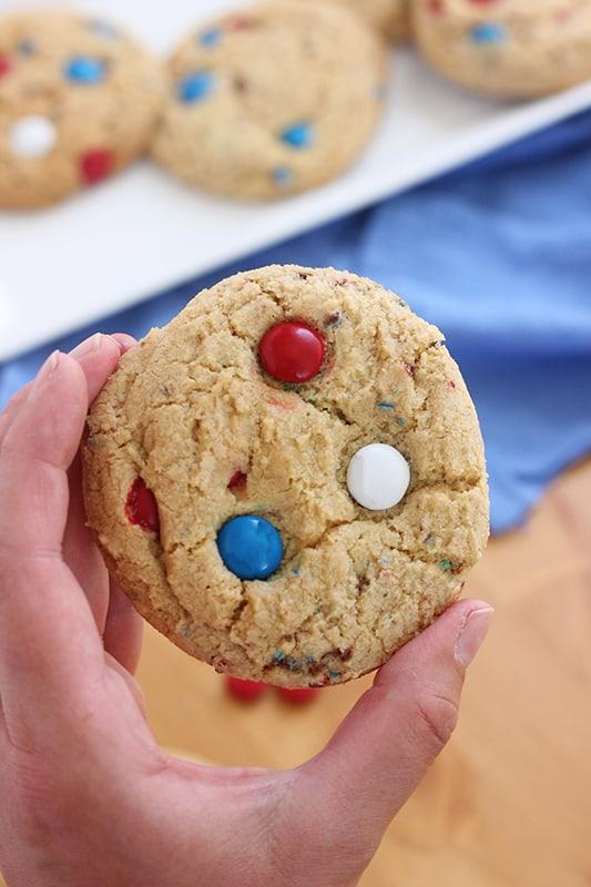 Patriotic M&M cookie held in hand