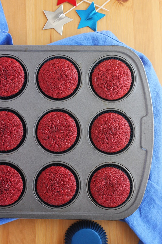 red velvet cupcakes in a baking tin