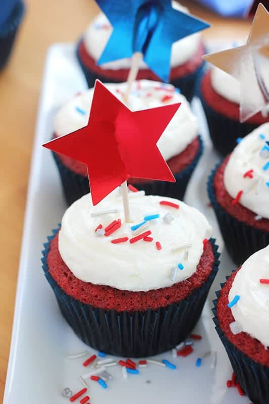 red velvet cupcake decorated with red white and blue sprinkles and a red star