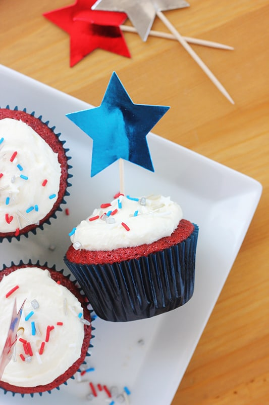 decorated 4th of july cupcake on a white plate