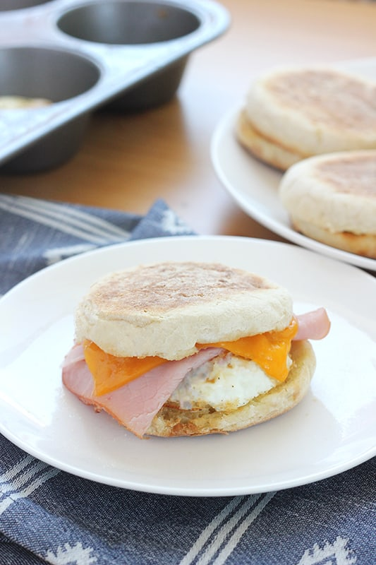 ham egg and cheese breakfast sandwich on a white plate