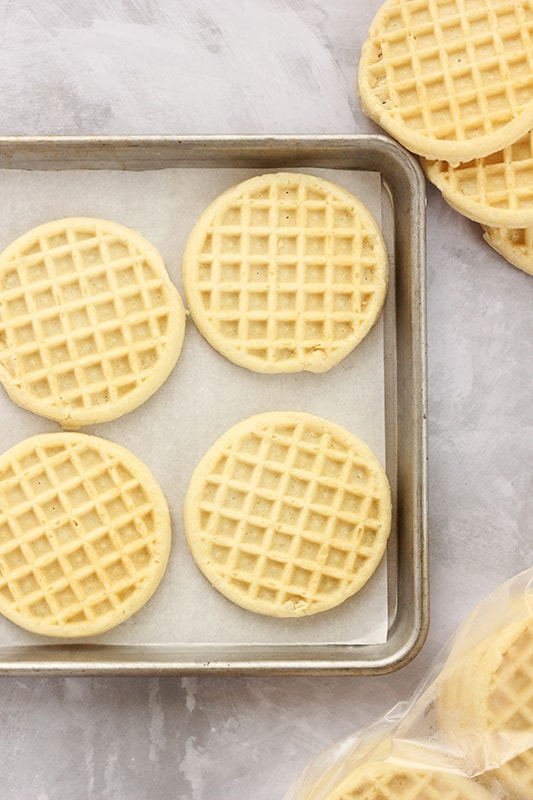 Waffles lined on a baking sheet ready to be toasted