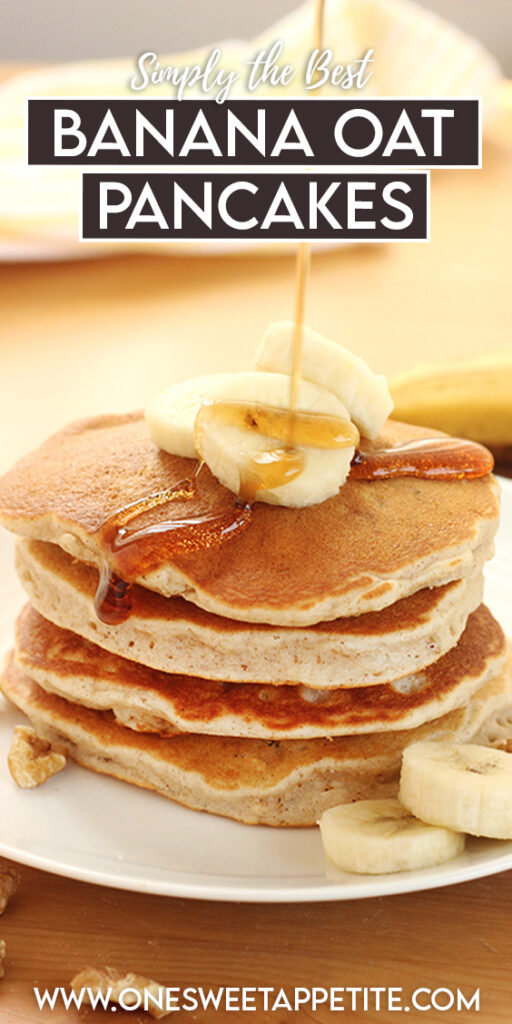 Stack of banana pancakes with banana slices and almonds on a white plate