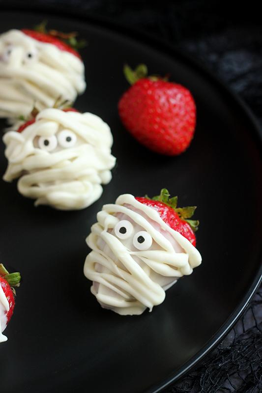 Mummy Halloween strawberry on a black plate